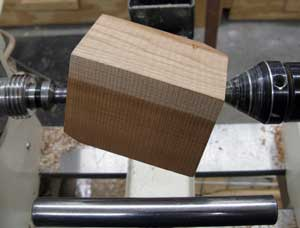 Cherry blank Mounted on the lathe.